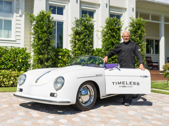 Chef David Nelson shows off the classic Porsche replica that will be used for deliveries in Naples for Timeless – An MHK Eatery, targeted to open March 1 at 90 Ninth St. N.