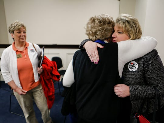 """Kentucky Education Association president Stephanie Winkler, right, gets a hug from former KEA president and retired school teacher Joyce Dotson after the Charter schools bill 520 passed out of the House Education committee on Friday morning. """"It's a very emotional day for me as a public school teacher,"""" Winkler said. """"I don't feel like a parallel system is going to do anything to close achievement gaps."""" The bill passed with several changes from what was originally filed. March 3, 2017"""