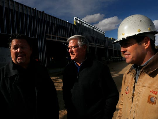 Property owners Kerwin Gober, left, and Terry Tobey join Jeffrey Cillessen, president of B & M Cillessen Construction Co. Inc. Thursday to talk about construction progress at the new GoTo Plaza in Farmington.