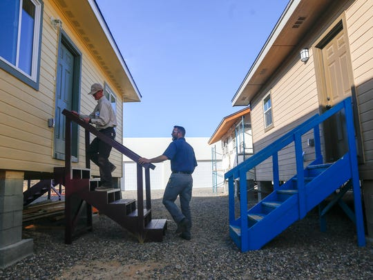 San Juan College School of Trades and Technology Instructor Zack Pettijohn, left, and coordinator Chad Triplett show the homes to be auctioned off on Tuesday at San Juan College in Farmington.