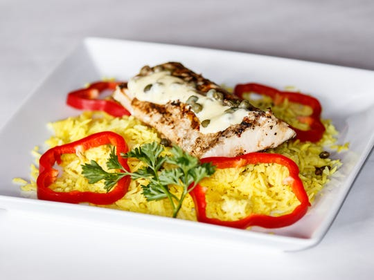 Grilled mahi mahi on a bed of rice pilaf is among the variety of dishes served as served by The Pub in downtown Oconomowoc.