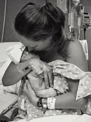 Talia Gates kisses her daughter, Aubrey.