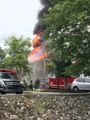 A fire burns at the Bell Walker's Crossing apartments
