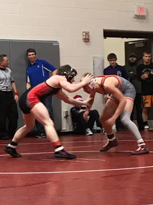 Ridgedale's Kalib Patterson, left, wrestles Van Wert's Josh Dorsch in the third-place match at the 47th Marion Harding Wrestling Classic. Patterson won by major decision 15-3.