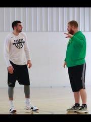 Joey Burton, right, coaches Dakota Mathias in a Zionsville