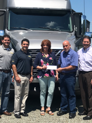 From left, Mike Burr, vice president and sales manager, Burr Truck & Trailer Sales Inc.; Chuck Burr, president and owner, Burr Truck & Trailer Sales; Laurie Abess, co-founder, A Room to Heal; Steve Erwin; and Mike Moehringer, general manager, Clinton's Ditch Coop Co Inc.