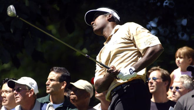 Vijay Singh watches his shot from the third tee during the third round of the Buick Classic at the Westchester Country Club June 12, 2004.