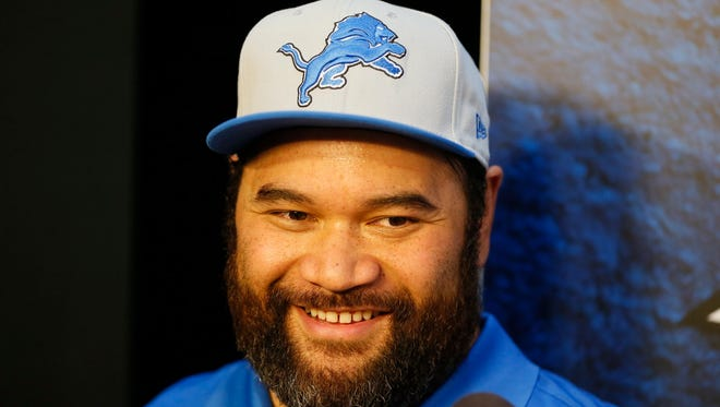 New Detroit Lions defensive tackle Haloti Ngata, acquired in a trade with the Baltimore Ravens , talks to the media after his formal press conference at Lions headquarters in Allen Park today.