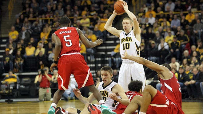Iowa's Mike Gesell scoops up a loose ball during the Hawkeyes' game against Nebraska at Carver-Hawkeye Arena on Tuesday, Jan. 5, 2016.
