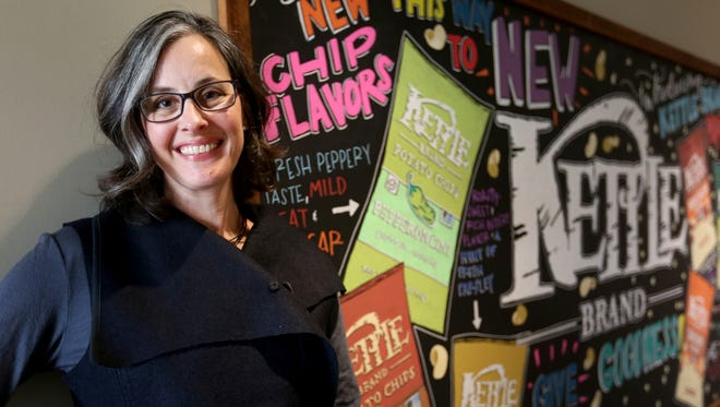 Carolyn Ottenheimer, the chief flavor architect for Kettle Brand Chips, stands for a photo with new flavors being produced at the Kettle Foods building in Salem.
