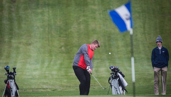 Wapahani's Connor Hensley competes in the Delaware County Boys Golf Tournament at the Muncie Elks Country Club Lodge Wednesday, May 4, 2016.
