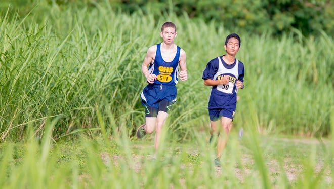 Harvest Christian Academy and Guam High School race during a cross country meet on on Sept. 1 at Harvest Christian Academy in Toto.