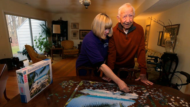 Chris Martin of East Brunswick, a caregiver for Executive Home Care, assists Howard Slade, 93, of Englishtown with daily needs and activities at his home
