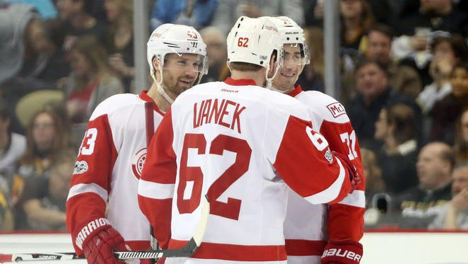 Red Wings center Darren Helm (43) and center Dylan Larkin (71) congratulate left wing Thomas Vanek (62) after Vanek scored a goal during the third period of the Wings' 5-2 win Sunday, Feb. 19, 2017 in Pittsburgh.
