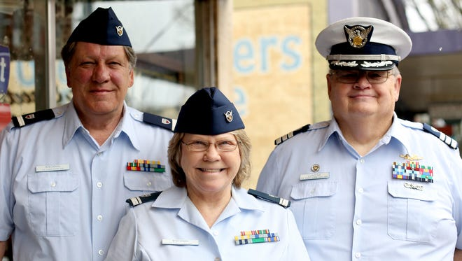 Paul Boeckman, from left, Paula Boeckman and Curt Lundine, with the U.S. Coast Guard Auxiliary, invite people to a boating safety course at the Salem Elks Lodge on Saturday, March 25, 2017.