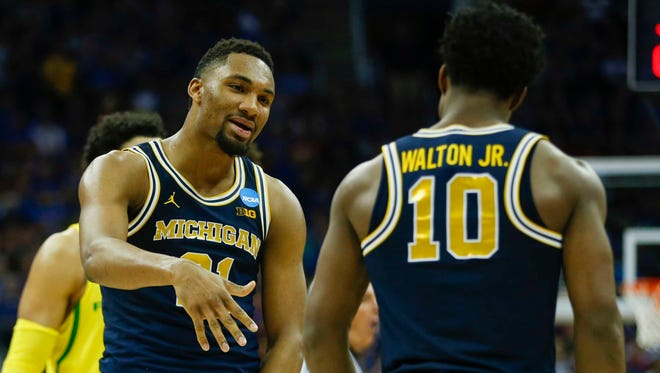 Mar 23, 2017; Kansas City, MO, USA; Michigan's Zak Irvin reacts with Derrick Walton Jr. during the second half against Oregon in the Midwest Regional of the NCAA tournament.