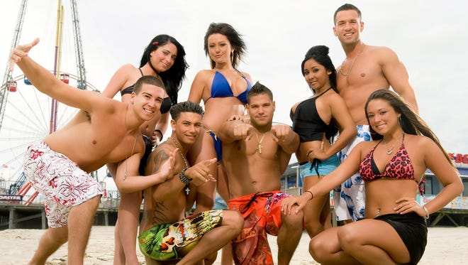 """A 2009 MTV photo shows the cast of """"Jersey Shore,"""" from left, Vinny Guadagnino, Angelina Pivarnick, Paul """" DJ Pauly D"""" Delvecchio, Jenni """"JWOWW"""" Farley, Ronnie Magro, Nicole """"Snooki"""" Polizzi,  Mike """"The Situation"""" Sorrentino and Sammi """"Sweetheart"""" Giancola."""