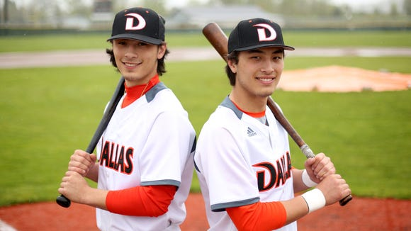 Tanner Earhart, left, a senior outfielder, and his brother Treve Earhart, a junior catcher, at Dallas High School in Dallas, Ore., on Monday, April 17, 2017.