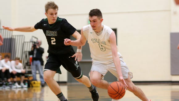 West Salem's Kyle Greeley (5) runs past Sheldon's JR Wulf (2) in the second half of the Sheldon vs. West Salem boy's basketball game, in the first round of the OSAA State Championships playoffs, at West Salem High School on Tuesday, Feb. 28, 2017. West Salem won the game 71-59.