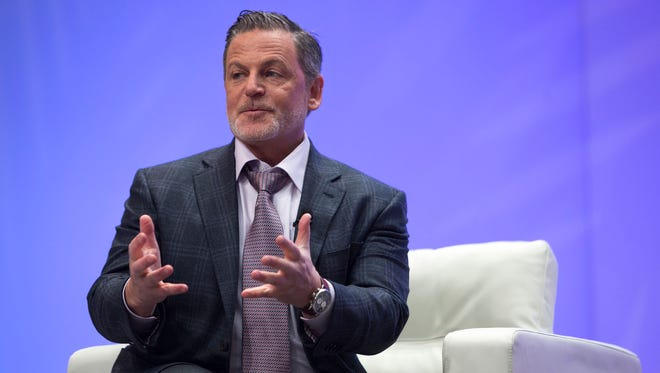 Dan Gilbert, owner of Quicken Loans and the Cleveland Cavaliers, speaks with Bloomberg's Betty Liu in January 2017 at the North American International Auto Show at Cobo Center in downtown Detroit.