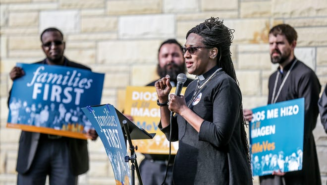 A faith leader speaks during an interfaith news conference and prayer service on the Deffered Action for Childhood Arrivals program held at St. Gabriel Church in Indianapolis on Sept. 5, 2017.