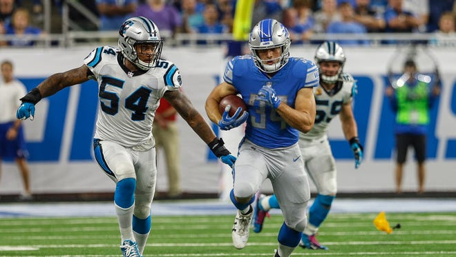 Zach Zenner runs in the first half of the Lions' 27-24 loss to the Carolina Panthers at Ford Field on Sunday, Oct. 8, 2017.