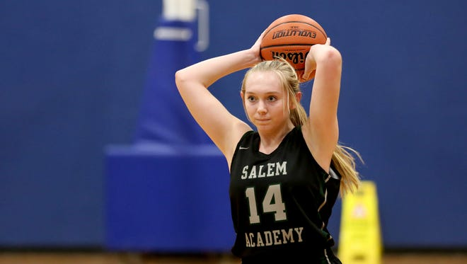 Salem Academy's Grace Brown (14) looks to pass the ball in the first half of the Salem Academy vs. Blanchet girls basketball game at Blanchet Catholic School in Salem on Wednesday, Jan. 3, 2018. Salem Academy won the game 50-24.