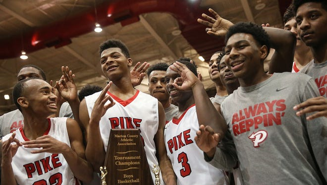 Pike players celebrate a third straight Marion County title last season. Can the Red Devils make it four in a row?