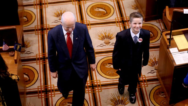 Dom Peters, Oregon's first Kid Governor and a fifth grader at Willamette Valley Christian School, and Secretary of State Dennis Richardson exit the Senate Floor following Dom's inauguration ceremony at the Oregon State Capitol in Salem on Monday, Jan. 8, 2018.