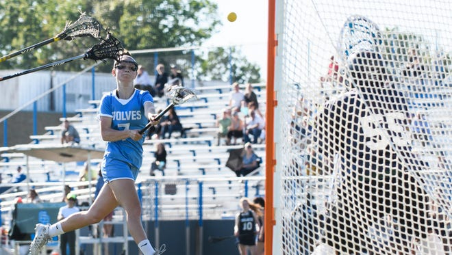 South Burlington's Dakota Crane (7) takes a shot during the girls lacrosse game between the Burlington Sea Wolves and the South Burlington Wolves at South Burlington High School on Tuesday afternoon May 29, 2018 in South Burlington.