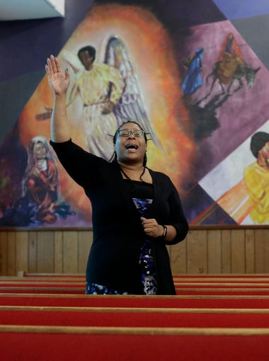 Dominique Moore sings during Big Bend Apostolic Ministerial Alliance's Pentecost Sunday service at Philadelphia Primitive Baptist Church on Dunn Street June 4.