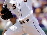 LSU's Jared Poche' throws a pitch against Southeastern Louisiana during an NCAA college baseball tournament regional game in Baton Rouge, La., Friday May 30, 2014. (AP Photo/Stacy Revere)