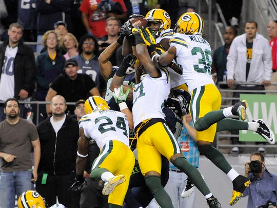 Packers defender Sam Shields lies on the ground as players scramble for the ball in the end zone on Sept. 24, 2012, at CenturyLink Field in Seattle.