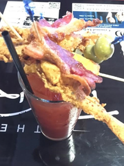 Tin Roof's build-your-own Bloody Mary can be piled high with all kinds of delicious options. This one includes freshly fried frog legs, which were perfectly battered and crunchy.