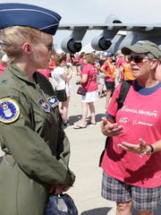 Air Force Brig. Gen. Jeannie Leavitt talks with Anne Wright of Ann Arbor, Michigan, talk after the WomanVenture Group photo Wednesday, July 25, 2018, in Oshkosh.