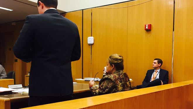 Lorraine S. Morgan, former academic officer for the Brick Board of Education,  sits next to her attorney, Michael R. Roberts, as he argues at a hearing on March 18 for her entry into a program to avoid prosecution on official misconduct charges.