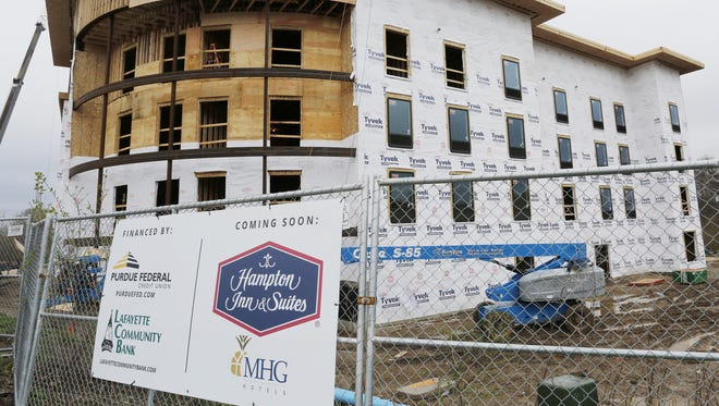 Development thrives in West Lafayette, such as the Hampton Inn & Suites under construction at the corner of State Street and Tapawingo Drive. Now the city is considering whether it is time to increase building permit fees