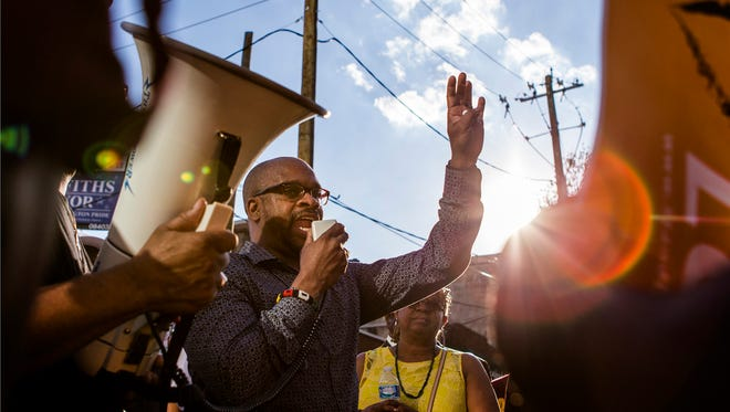 Reverend Donald Morton speaks to a crowd of activists at the intersection of King and Fourth Streets in Wilmington on Monday evening.