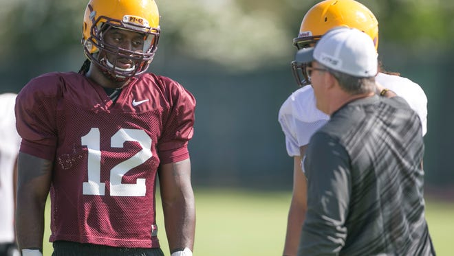 Arizona State's De'Marieya Nelson listens to instruction from coach Todd Graham during practice Aug. 3 in Tempe.