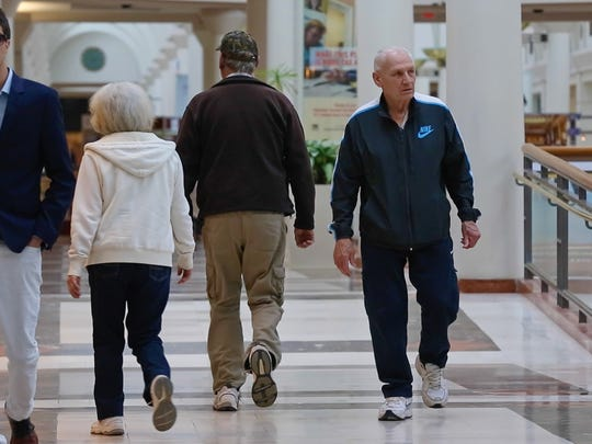 Rudy D'Emilio goes to the Menlo Park Mall regularly and walks its hallways to get exercise.