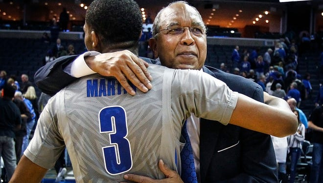 University of Memphis head coach Tubby Smith hugs guard Jeremiah Martin (left) after defeating University of Central Florida 70-65 at the FedExForum.