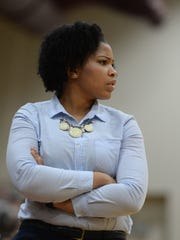 Seton girls basketball coach Karmell Brown watches action against Hagerstown during a game Saturday, Jan. 2, 2016, at Earlham College in Richmond.