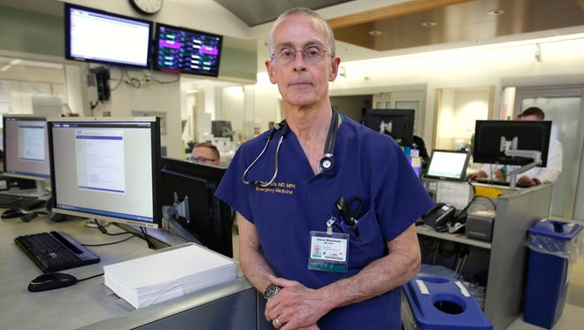 Dr. Garen Wintemute, an emergency room physician at the University of California, Davis, Medical Center, poses for a photo at the hospital in Sacramento, Calif. Wintemute, who has researched gun violence and firearms industry, worked with colleagues to download public records from the Bureau of Alcohol, Tobacco and Firearms and other federal agencies after the inauguration of President Donald Trump. He and others feared the information might disappear from federal websites.