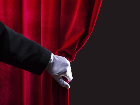 Theater curtain opens
