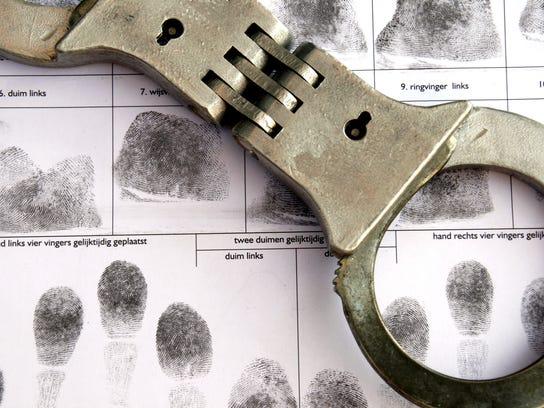 -CRIME cuffs over fingerprint sheet.jpg_20140114.jpg