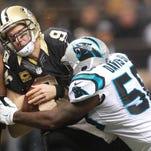 Panthers linebacker Thomas Davis sacks Saints quarterback Drew Brees Sunday afternoon at Mercedes-Benz Superdome.