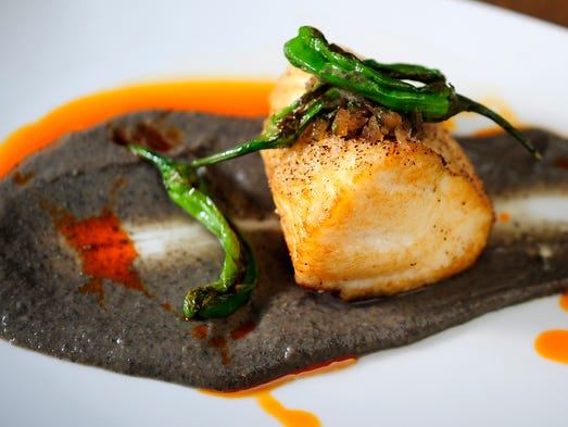 1808 Grille's crispy wreckfish features jalapeño blackbean puree, charred Shishito peppers and onion jam.