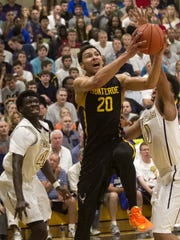 Montverde Academy's Ben Simmons is fouled by Wheeler's Hakeem Anchrum as he goes up for a shot in the championship game of the 42nd Annual Culligan City of Palms Classic on Tuesday, December 23, 2014 at Bishop Verot High School in Fort Myers.