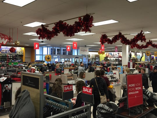 Shoppers wait in long lines near the checkout at Kohl's in Plover on Friday morning.
