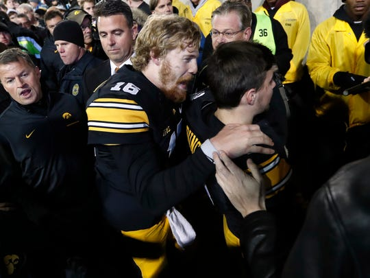Iowa quarterback C.J. Beathard (16) celebrates with